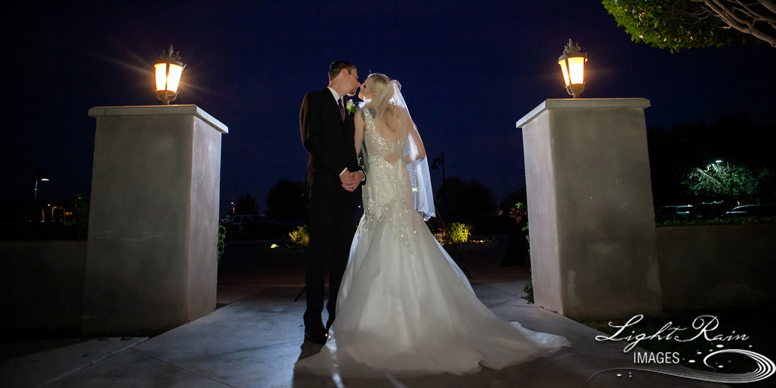 bride and groom kissing in twilight