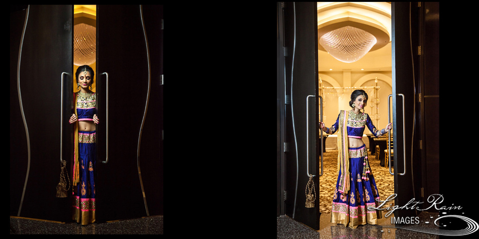 A beautiful Indian bride at reception night, dressed in blue, gold and and pink lengha ensemble.
