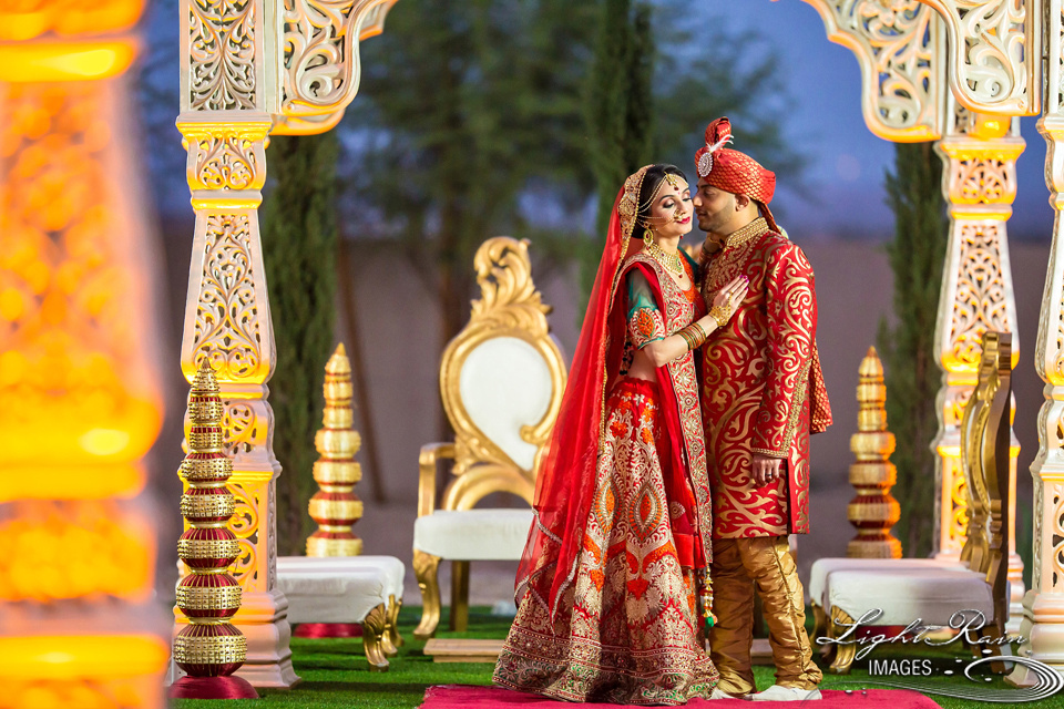 Indian wedding couple by Mandap