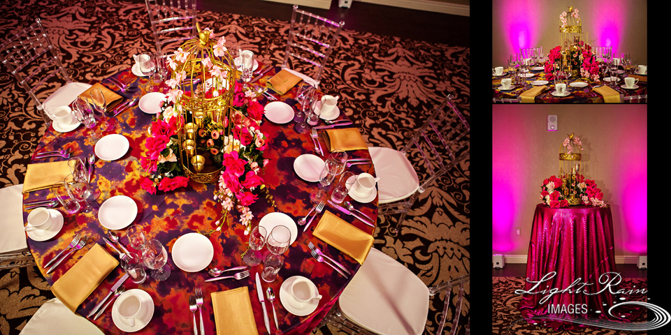 Top view of gold and fuchsia tablescape with gold chiavari chairs for Indian wedding reception.
